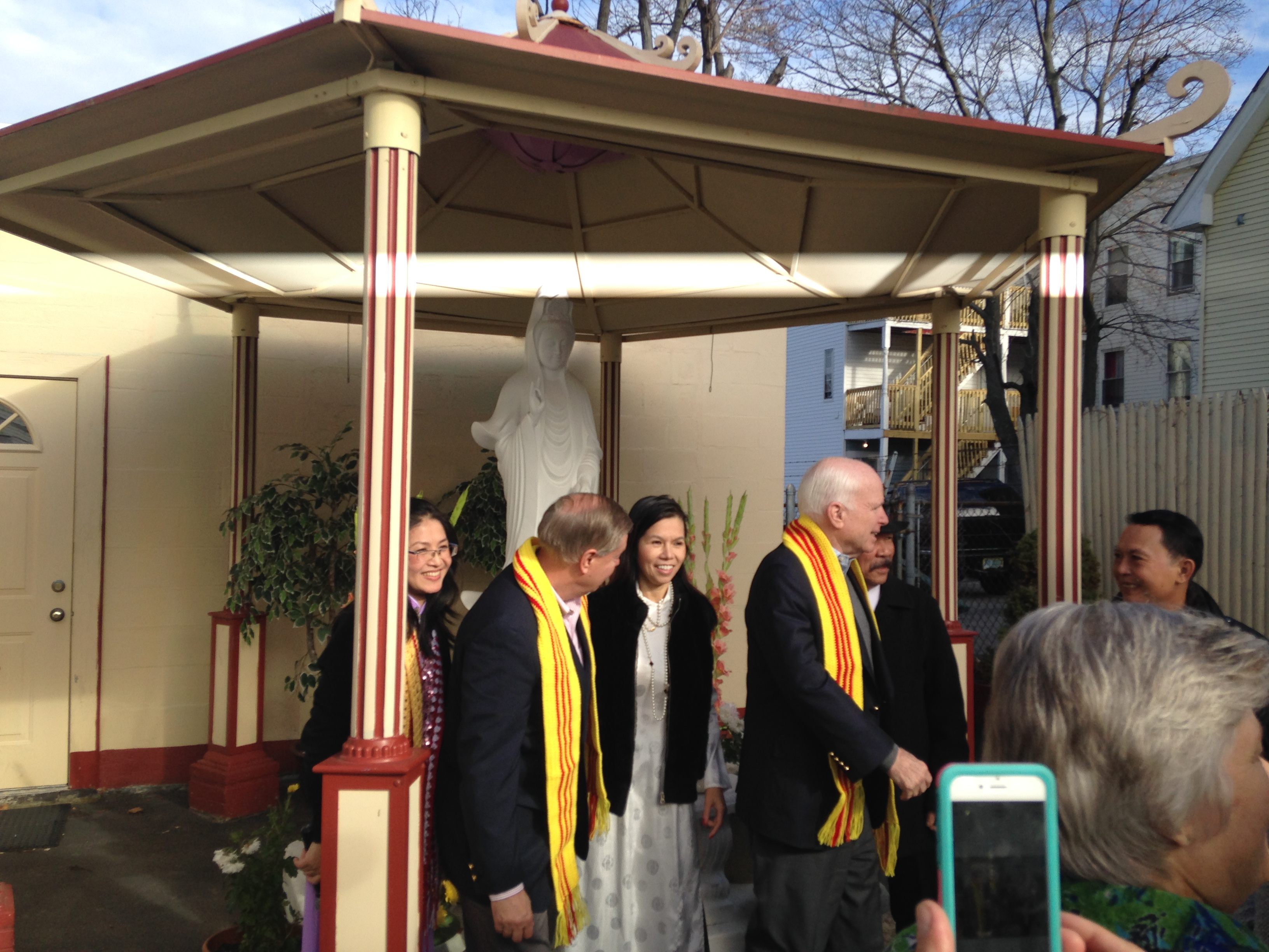Chau Kelley and Candy Phan with Sens. Lindsey Graham and John McCain at a Vietnamese temple in New Hampshire on Saturday Nov 21